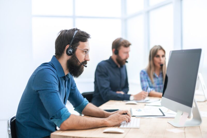Three People Desktop Support Headset Computers