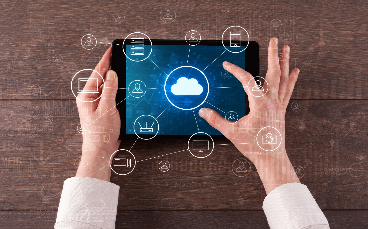 Two Hands Looking at Cloud Applications on a Tablet