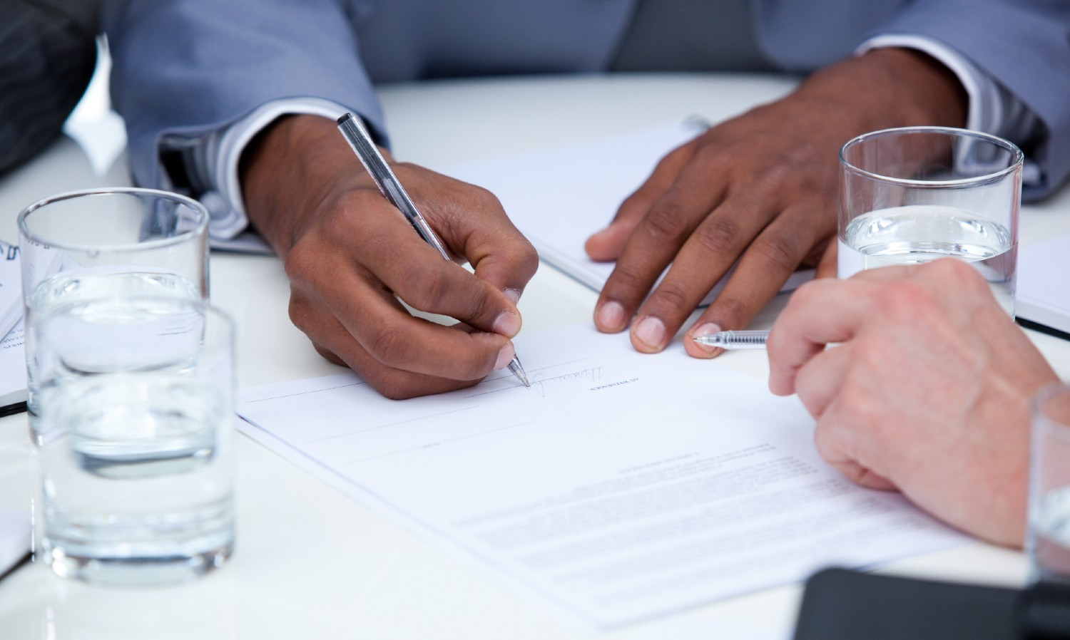 Two Business People Closing Deal